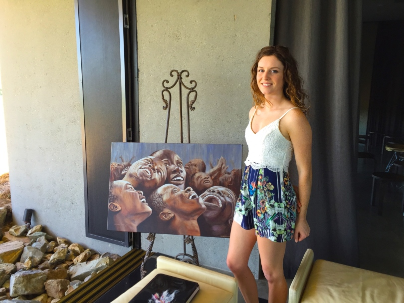 "Rebekah Codlin next to her painting ""African Rain"""