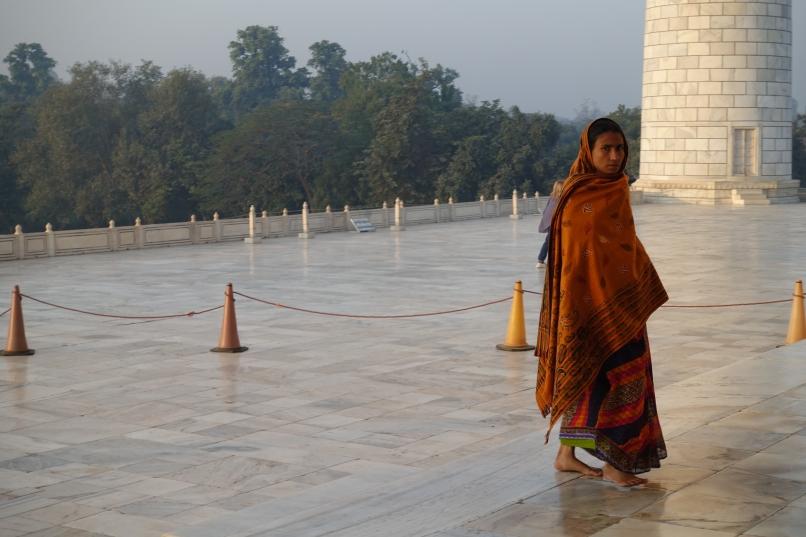 Woman in orange sari outside Taj Mahal India