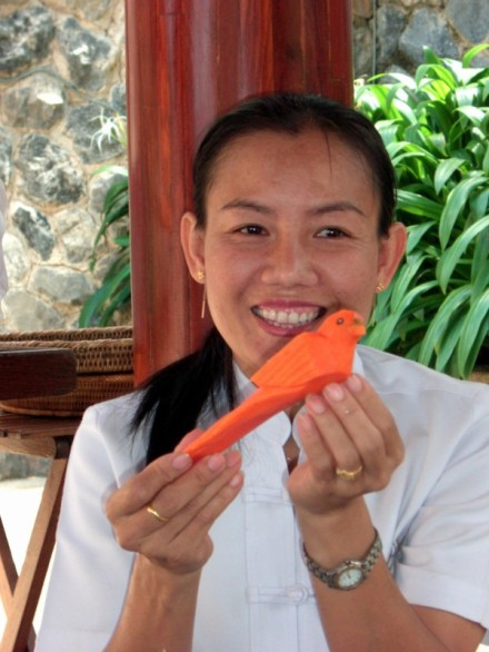 Carving a bird in Thailand